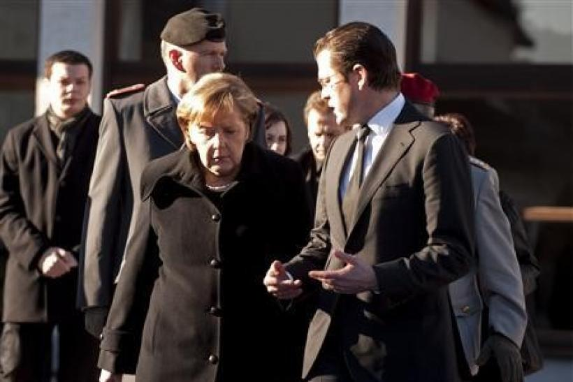 German Chancellor Angela Merkel and Defence Minister Karl-Theodor zu Guttenberg
