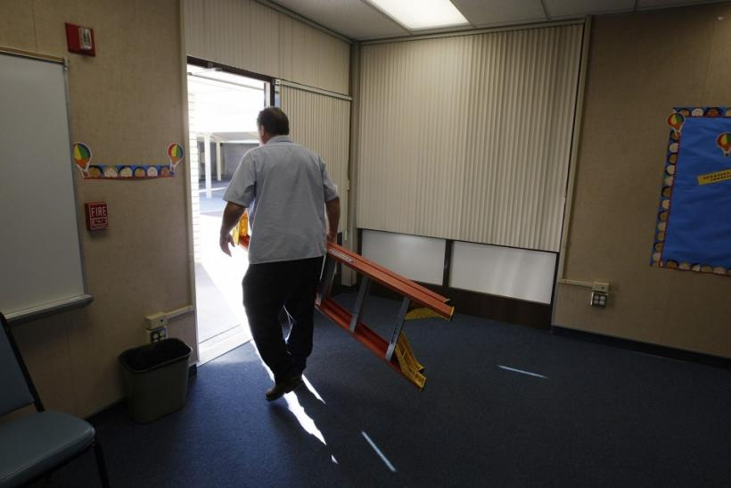 Maintenance worker Kent Burrows makes repairs at former Telechron Elementary School, which became the administrative offices of the South Whittier School District after budget problems forced the school to close this year, in Whittier, California,