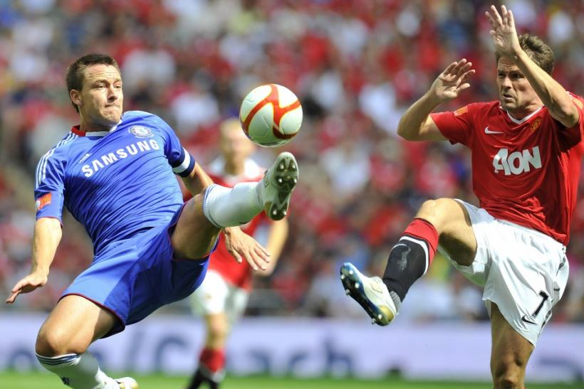 Chelsea's Terry and Manchester United's Owen challenge for the ball during their English Community Shield soccer match in London
