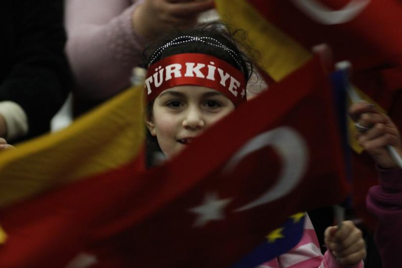 A Turkish girl waves a German and a Turkish flag during the arrival of Turkish Prime Minister Tayyip Erdogan in Duesseldorf
