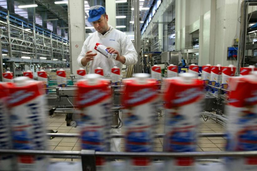 A WORKER INSPECTS BOTTLED MILK INSIDE PARMALAT'S MAIN FACTORY AT COLLECCHIO NEAR PARMA.