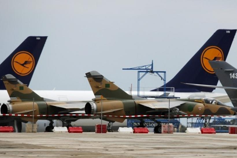Two Libyan Air Force Mirage F1 fighter jets are seen on the apron at Malta International Airport outside Valletta, February 26, 2011.