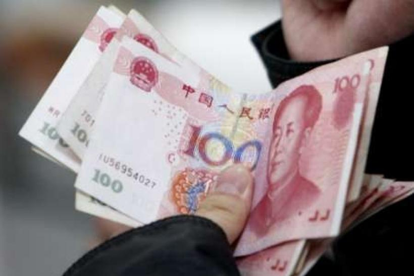 Fitch downgrades China's local currency debt rating outlook
