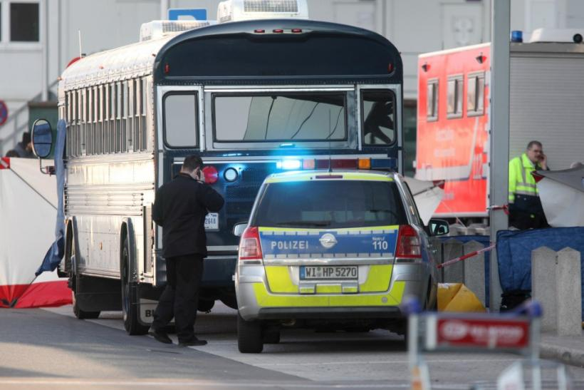 A police car stands next to an U.S. Army bus in front of Frankfurt airport