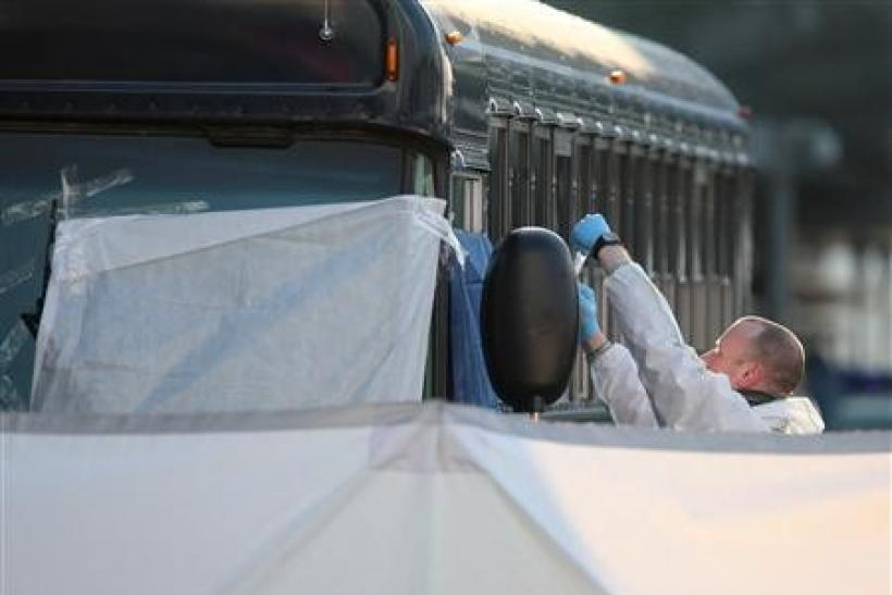 A forensic expert examines an U.S. Army bus in front of Frankfurt airport