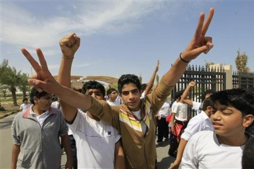 High school students gesture, during a protest to demand the resignation of the education minister