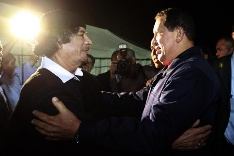 Libya's leader Muammar Gaddafi (L) greets Venezuela's President Hugo Chavez after their meeting in Tripoli October 22, 2010.