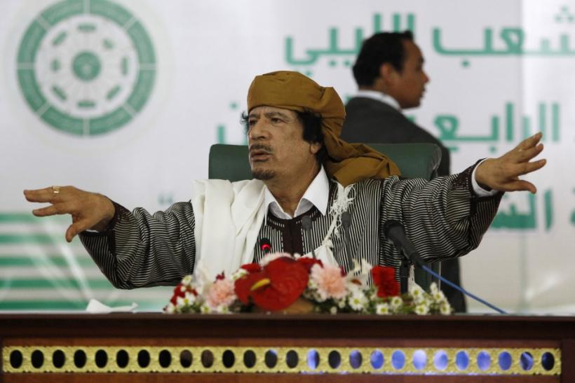 Libya's leader Muammar Gaddafi gestures to his supporters in Tripoli