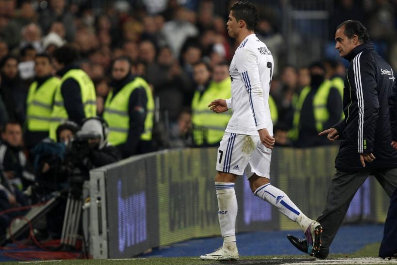 Real Madrid's Cristiano Ronaldo leaves the pitch during their Spanish first division soccer match against Malaga in Madrid.