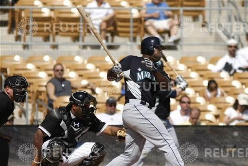 Seattle Mariners left fielder Milton Bradley doubles in the third inning during a MLB spring training baseball game against the Chicago White Sox in Glendale