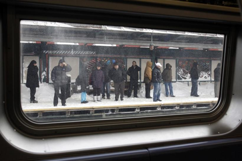 Passengers wait on a subway platform for a train in the Brooklyn section of New York