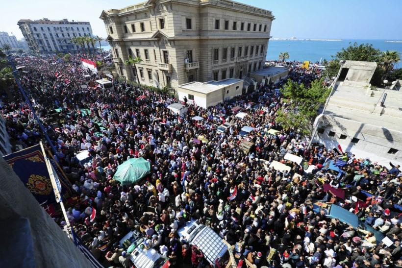 Egyptian pro-democracy supporters march in Alexandria