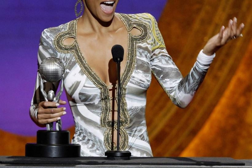 Actress Halle Berry accepts the award for Outstanding Actress in a Motion Picture for 'Frankie & Alice' at the 42nd Annual NAACP Image Awards at the Shrine auditorium in Los Angeles March 4, 2011.