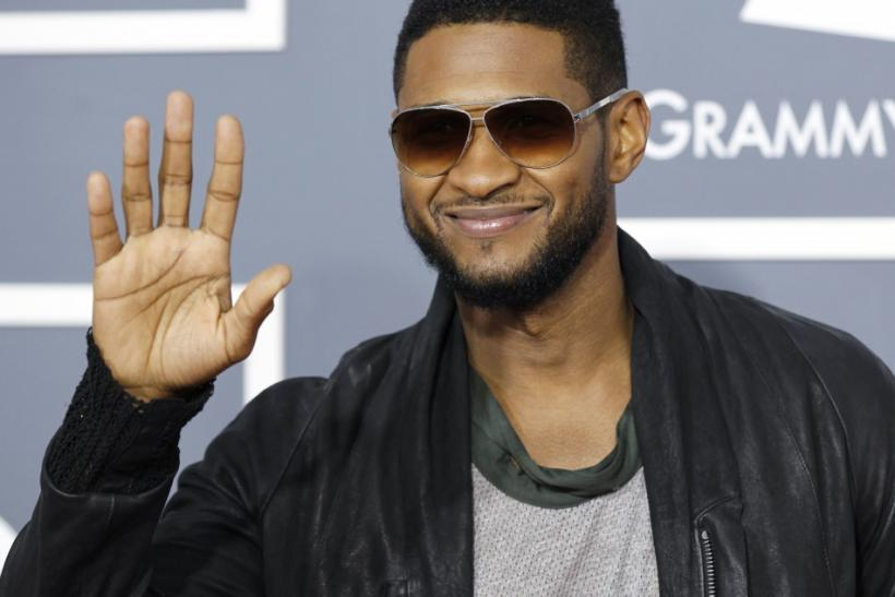 Usher poses on arrival at the 53rd annual Grammy Awards in Los Angeles