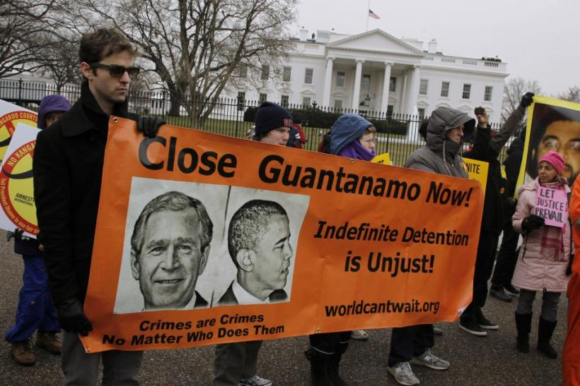 Protesters seeking the closure of the Guantanamo Bay detention facility demonstrate outside the White House in Washington, January 11, 2011.