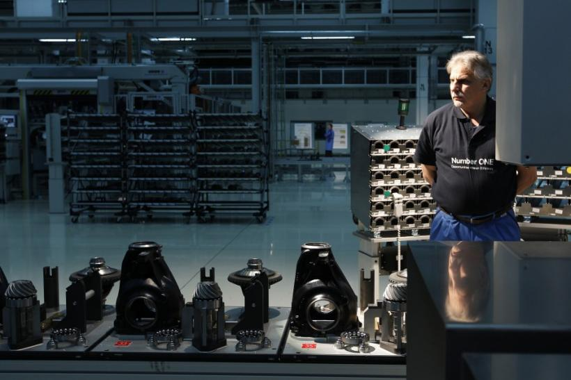 Employee Josef Kronschnabel stands next to the new axle gearing production line in Dingolfing