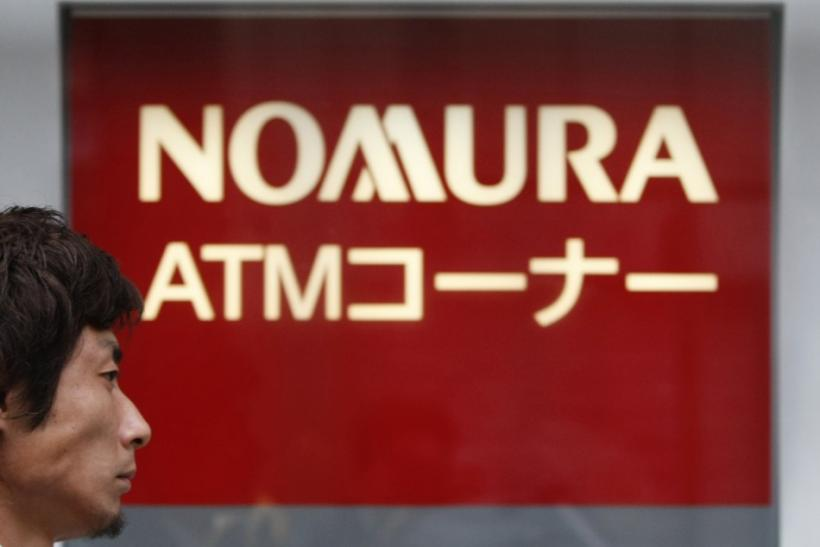 A man walks past a Nomura Securities branch in Tokyo