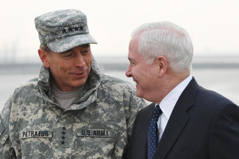 Commander of ISAF Afghanistan General Petraeus chats with US Defense Secretary Gates upon Gates' arrival in Kabul.