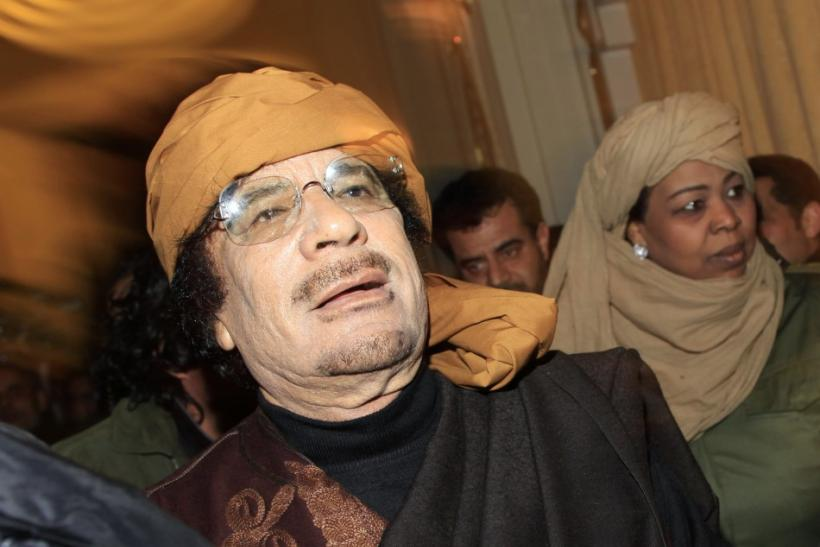 Libya's leader Moammar Gaddafi arrives to give television interviews at a hotel in Tripoli