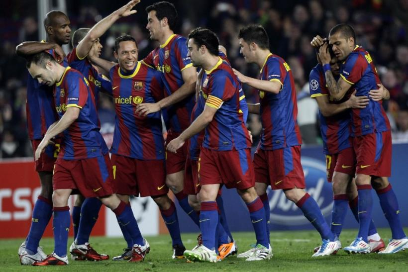 Barcelona players celebrate after scoring a goal during their Champions League soccer match in Barcelona.