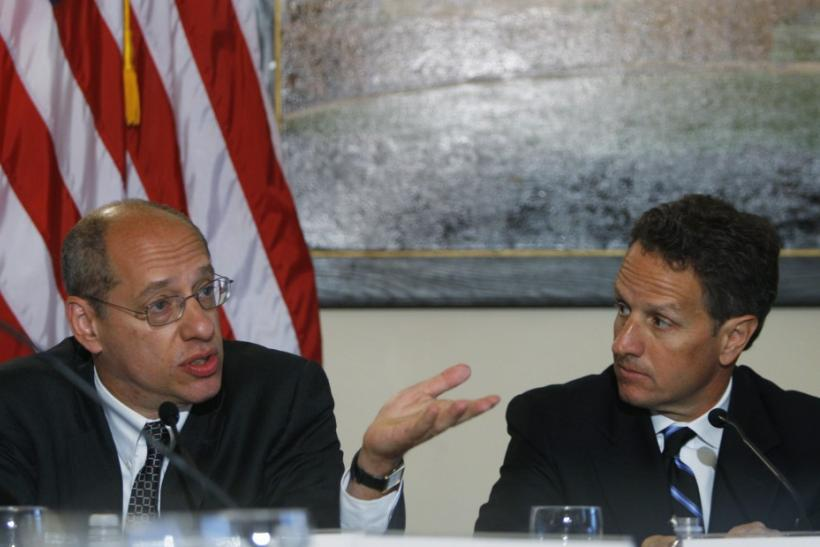 FTC Chairman Leibowitz speaks as U.S. Treasury Secretary Geithner looks on as they discuss efforts being made to combat mortgage modification fraud at a meeting at the Treasury Department in Washington