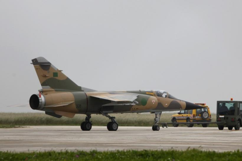 Libyan Air Force Mirage F1 fighter jet is towed to a more secure part of Malta International Airport outside Valletta