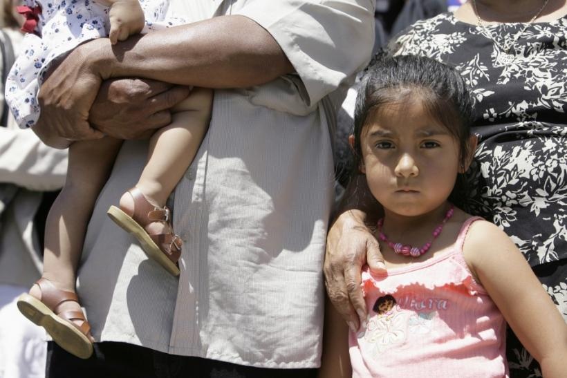 The five-year-old daughter of Juan stands between her father and her grandmother in front of La Plaza Methodist Church during the public launch of The New Sanctuary Movement in Los Angeles