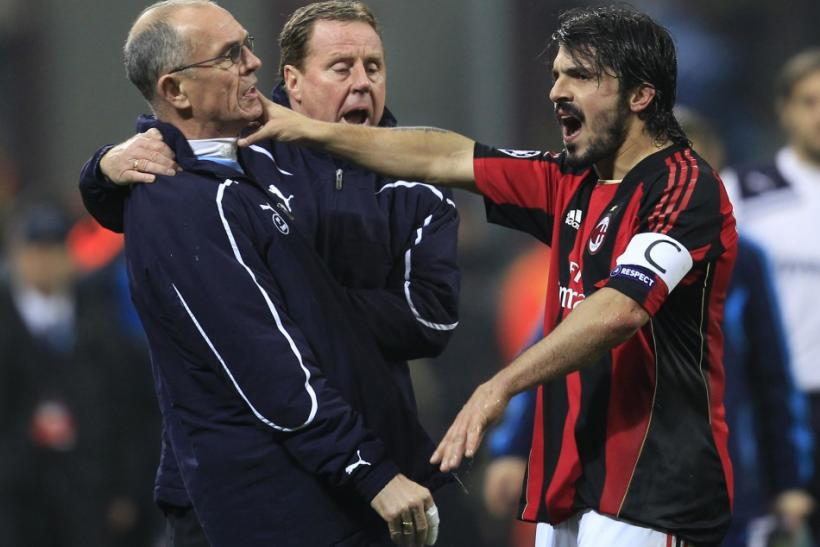 AC Milan's Gattuso argues with Tottenham Hotspur's first team coach Jordan next to manager Redknapp during their Champions League soccer match in Milan.