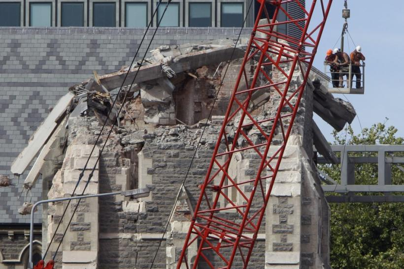 Recovery workers inspect the fallen spire of the Christchurch Cathedral in Christchurch