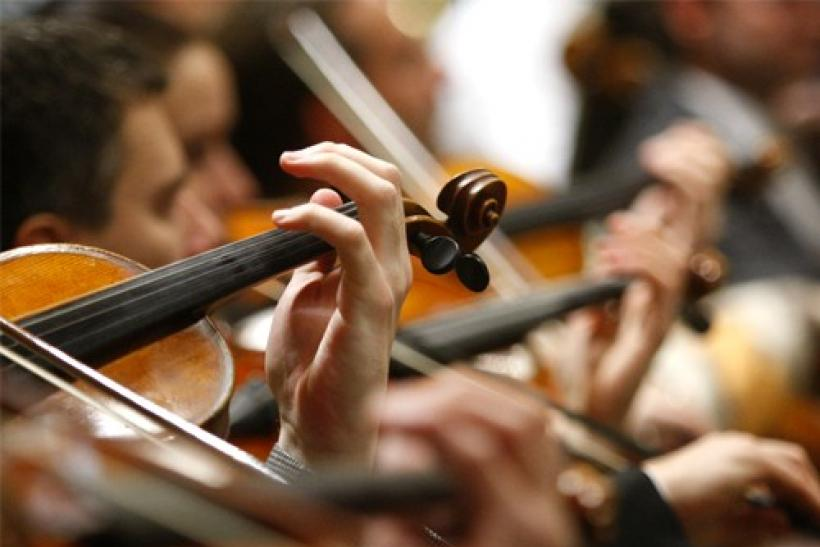 Musicians of the Vienna Philharmonic Orchestra perform during a rehearsal for the New Year's Concert 2011