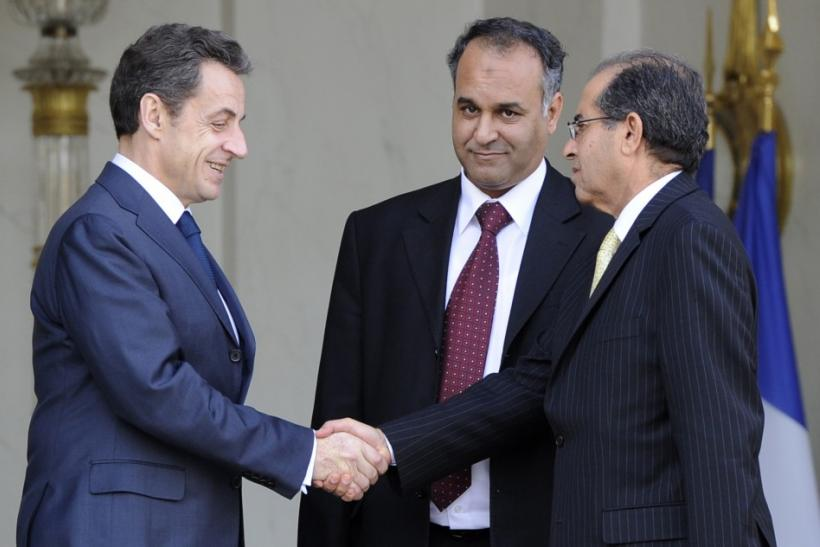 France's President Sarkozy escorts Libyan National Council emissaries and Mahmoud Jebril and Ali Essawi after a meeting at the Elysee Palace in Paris