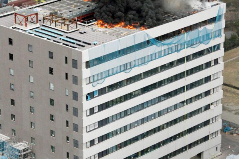An office building burns in Tokyo after an earthquake March 11, 2011. A massive 8.9 magnitude quake hit northeast Japan on Friday, causing many injuries, fires and a four-metre (13-ft) tsunami along parts of the country's coastline, NHK television and wit