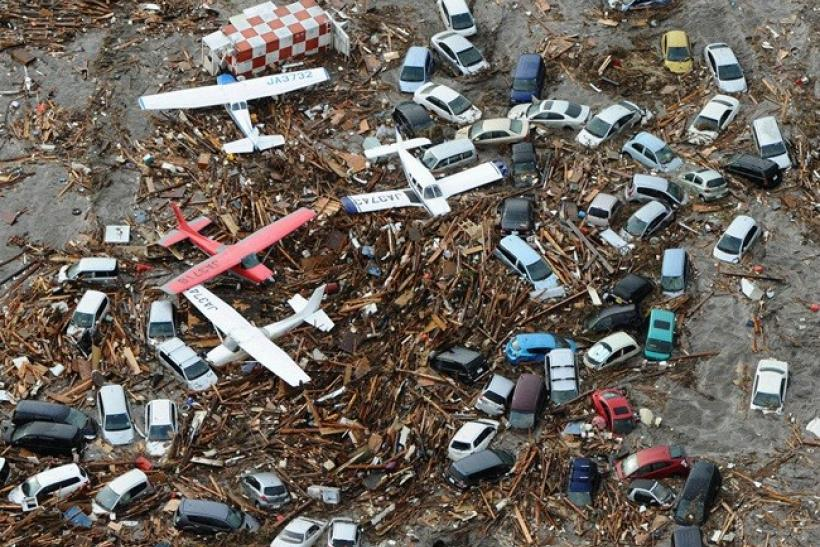 Cars and airplanes swept by a tsunami are pictured among debris at Sendai Airport, northeastern Japan March 11, 2011.