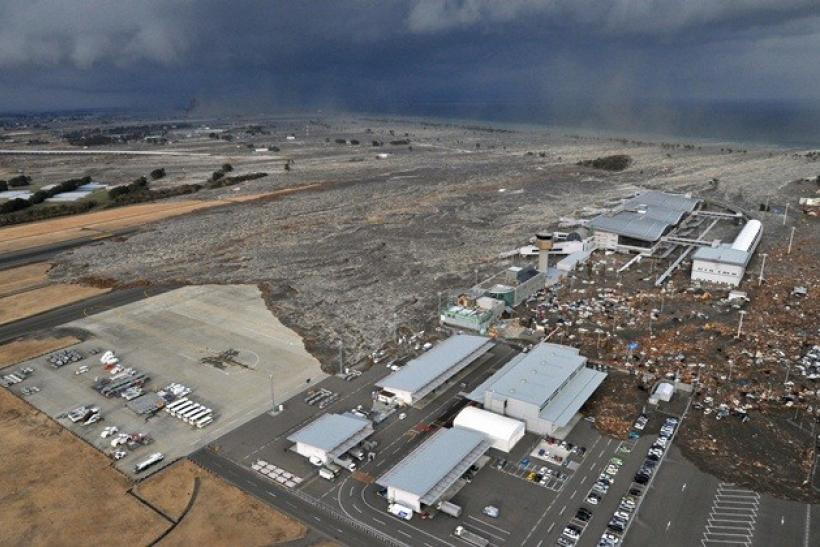 Sendai Airport is swept by a tsunami after an earthquake, in northeastern Japan March 11, 2011.