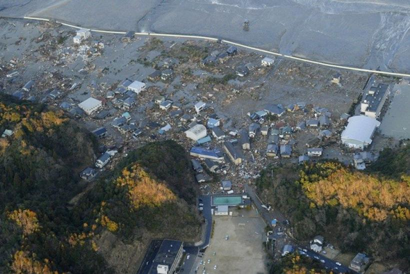 Buildings are damaged by a tsunami following an earthquake in Iwaki City, northeastern Japan March 11, 2011.