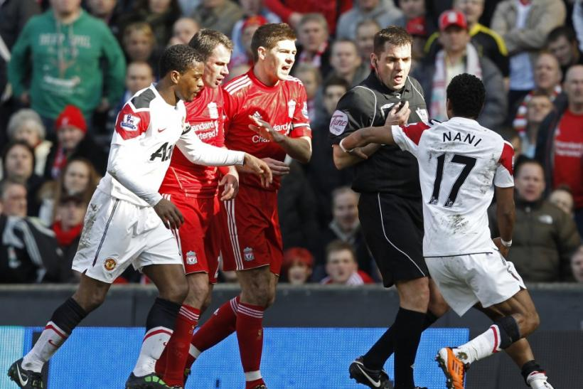 Manchester United's Nani reacts after a foul from Liverpool's Carragher during their English Premier League soccer match in Liverpool.