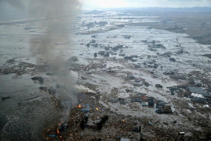 Fires burn in a harbour following an earthquake and tsunami in Natori City, Miyagi Prefecture, northeastern Japan, March 11, 2011.