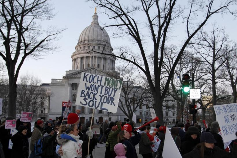 Protesters maintain a presence outside the Wisconsin State Capitol as the Wisconsin State Assembly meets in Madison, Wisconsin