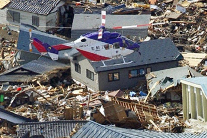 A victim is rescued by helicopter following an earthquake and tsunami in Iwate Prefecture, northeastern Japan March 12, 2011.