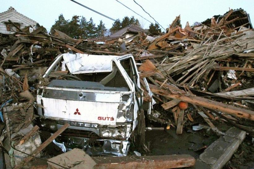 A truck and destroyed buildings swept by a tsunami following an earthquake are seen in Fukushima Prefecture, northeastern Japan March 12, 2011.