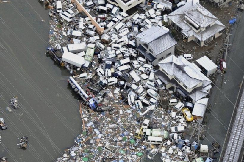 A large number of cars swept by a tsunami following an earthquake are seen in Sendai, northeastern Japan March 12, 2011.