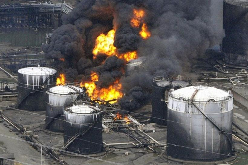 A factory facility burns following an earthquake and tsunami in Sendai, northeastern Japan March 12, 2011.