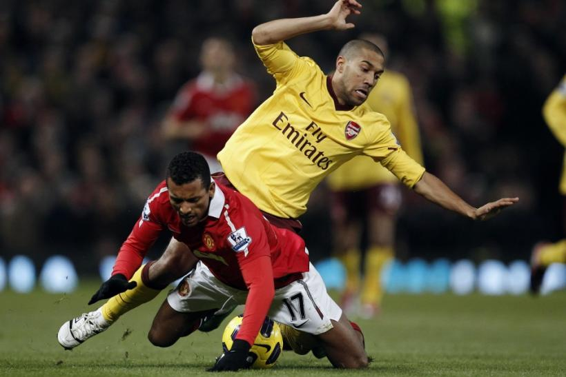 Arsenal's Clichy challenges Manchester United's Nani during their English Premier League soccer match at Old Trafford in Manchester.