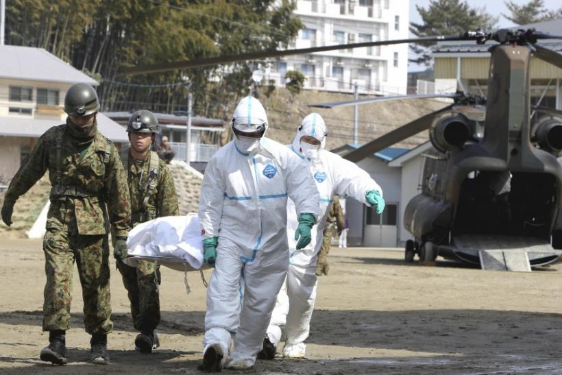 Japan Self-Defense Forces officers carry a victim who is suspected of being exposed to radiation in Nihonmatsu City