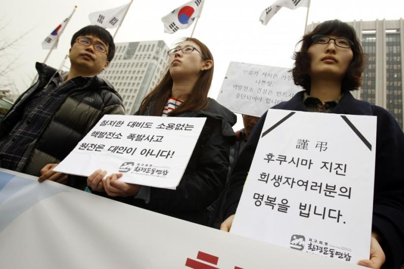 Environmental activists attend rally to mourn for victims of Japan's earthquake and tsunami, and to urge South Korean government to halt building of more nuclear plants in South Korea, in Seoul