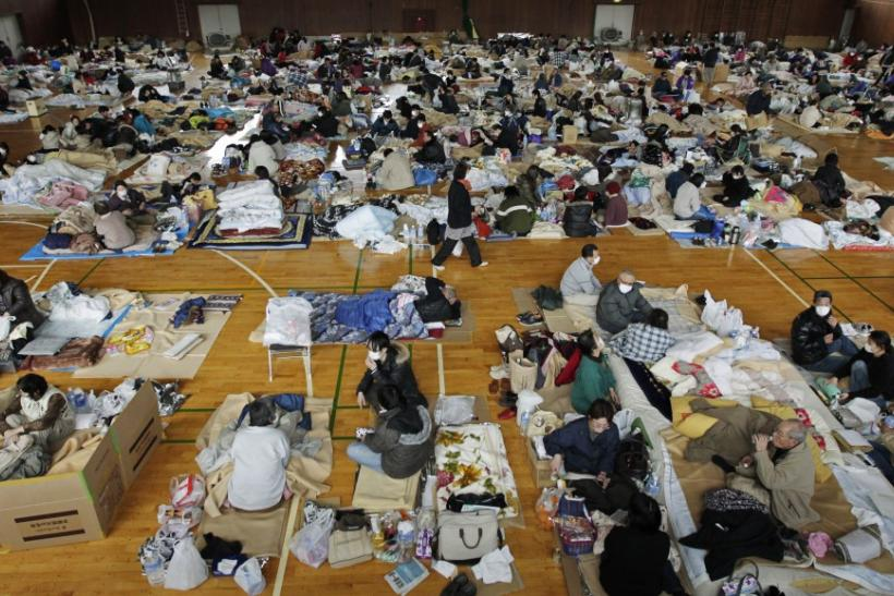 Evacuees, who fled from the vicinity of Fukushima nuclear power plant, rest at evacuation center in Kawamata