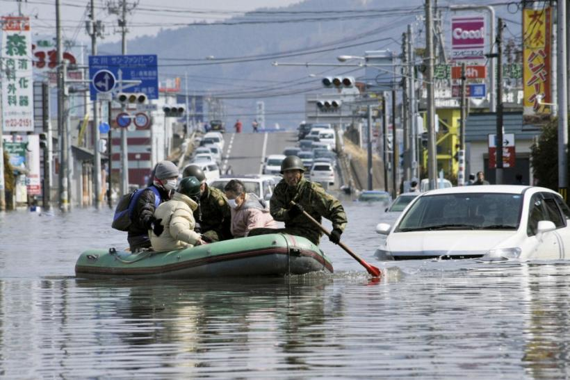 Japan Self Defence Forces troops rescue people from flooded areas in Ishimaki City, Miyagi Prefecture