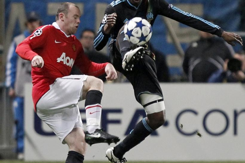 Olympique Marseille's Diawara challenges Manchester United's Rooney during their Champions League soccer match at the Velodrome stadium in Marseille.