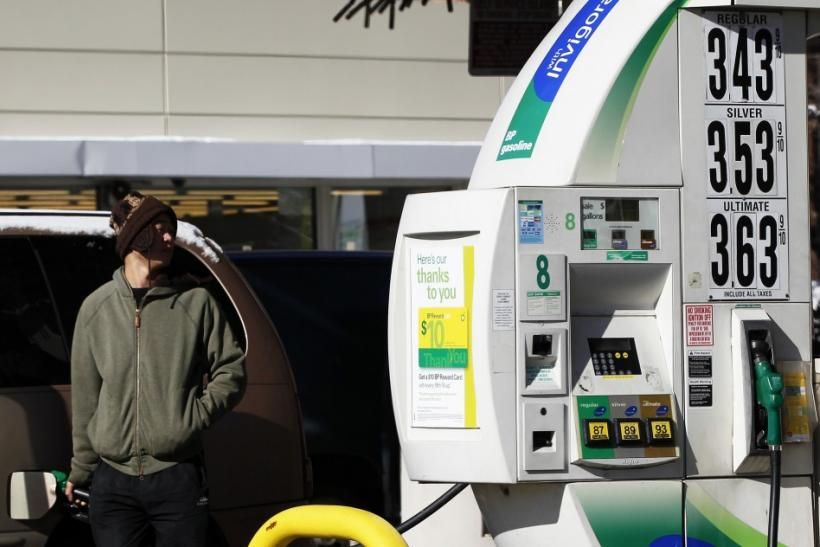 A man pumps gas into his vehicle at a petrol station in New York
