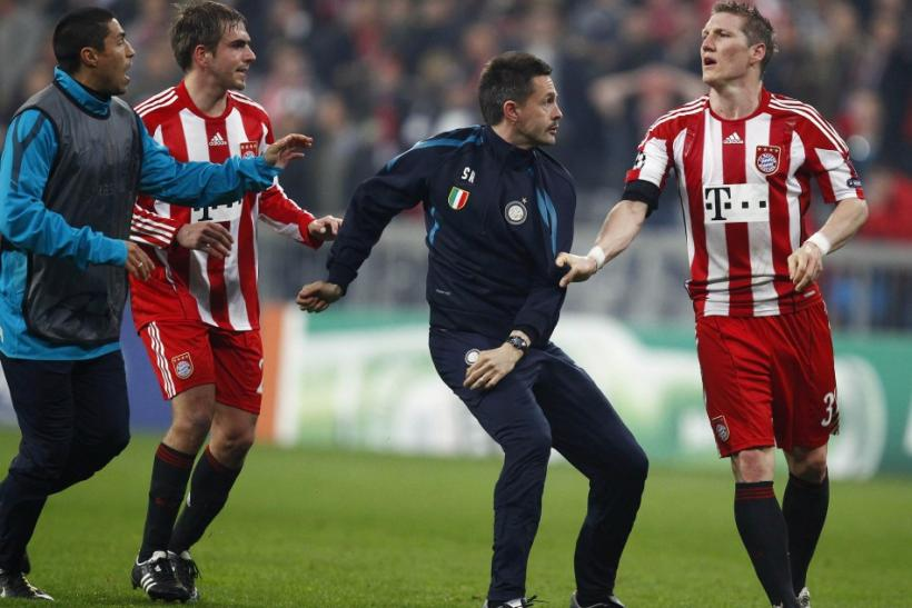 Bayern Munich's Bastian Schweinsteiger scuffles with an unidentified Inter Milan physio after their Champions League round of 16 second leg soccer match in Munich.